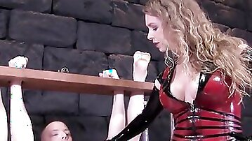 Mistress gives a firm-handed handjob to her helpless slave