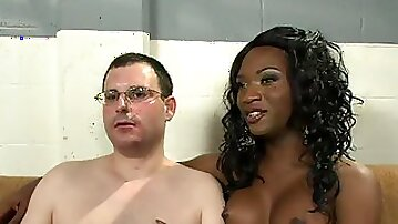 Black tranny examines and fingeres and fucks ass of white guy in gyno chair