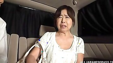 Amateur fucking in the back of the car with a mature Asian slut