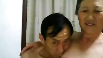 Chinese granny jerking off her husbands cock