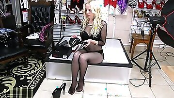 Fantastic blonde in nylon fishnet outfit trying on brand new sexy black shoes