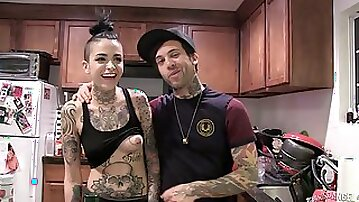 Girls show off their tattoos and chat behind the scenes