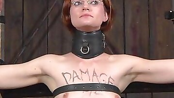 Redhead slave inserted with toy when tortured in BDSM