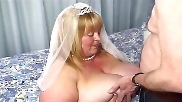 Grabbing her huge tits on her wedding day