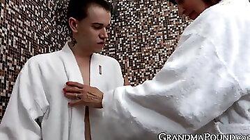 Slutty granny seduces innocent young man into shower sex