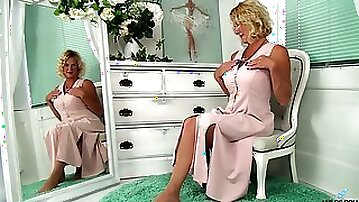 Svelte curly mature lady Molly Maracas plays with boobs before the mirror