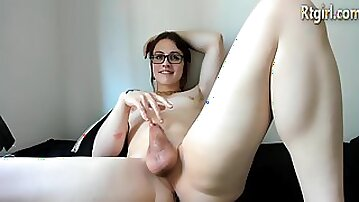 Cute american tgirl in glasses stroking off her cock