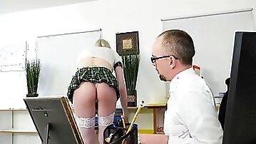 Blonde tranny is in a schoolgirl uniform while having bareback sex