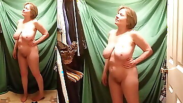Busty mature hottie strips for you