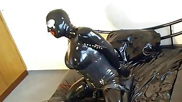 Tranny freak with big tits teases in rubber on webcam