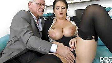 Full-bosomed secretary screwed in rear by older guy