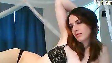 American brunette shemale babe teasing on cam