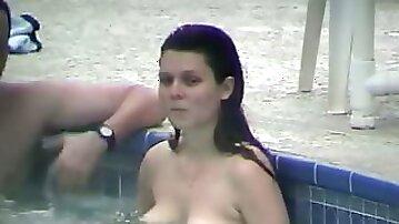 Juicy brunette is having fun in the pool
