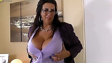 Horny mature chubby with huge tits toys herself with big rubber dildo