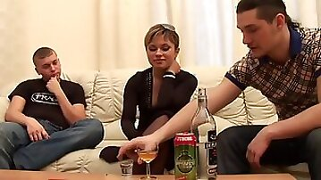 Two dudes and sexy Adelina share a drink and an orgy