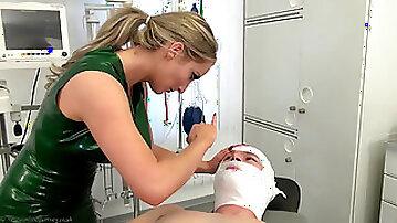 Female domination nurse checking patient