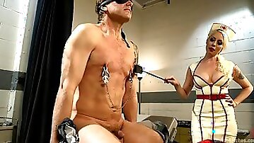 Sexy dominatrix in nurse outfit pegging a submissive guy in hospital