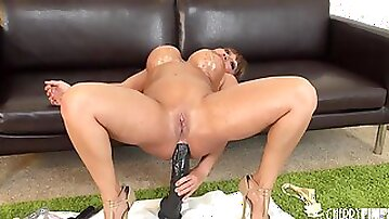 Big ass babe lubes her butthole and fucks it with toys
