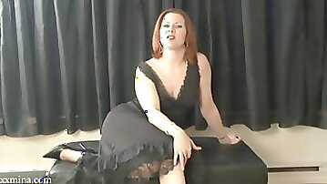 Stunning redhead toys with a dildo in solo masturbation shoot