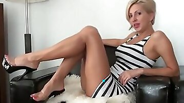 Stunning and sassy blonde milf lady teases me on webcam