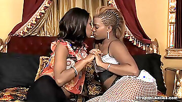 Ebony lesbian punished and fucked by a strap-on