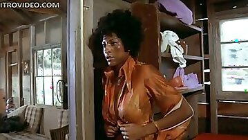 Insanely Busty Ebony Babe Pam Grier Unties Herself In Ragged Clothes