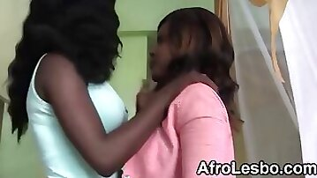Lesbian ebony beauties wrestling and sharing a good time