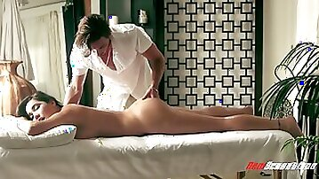 Lewd masseur works well of lubed cunt of Karlee Grey that she moans
