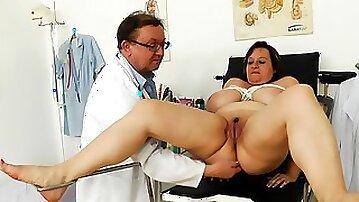 Mature BBW babe Olena doing a medical exam
