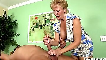 Blonde short haired mature sucks a dick like it is her last